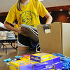 John Cross<br /> Andrea Bruns puts together school kits that will be distributed to needy children overseas through Lutheran World Relief. She and other youth were assembling the kits at Bethlehem Lutheran Church on Monday through CSI Mankato, a week-long volunteer service project.
