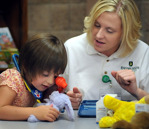 John Cross<br /> Rasmussen College nursing student Crystal Laxen assists Olive Purrier in an exam of her stuffed animal during a Teddy Bear Clinic at the Blue Earth County Library on Tuesday. The annual event is a collaborative effort of Child & Teen Checkups, Pediatric and Adolescent Dentistry and Blue Earth County.