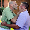 John Cross<br /> Joe Strong (left) and Rob Thomas kiss following their wedding ceremony at the Nicollet County Courthouse in St. Peter on Thursday.