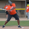 Bukata Hayes, Executive Director of the Greater Mankato Diversity Council, hits a home run on the first pitch delivered to him at the LEEP Legends softball game. The game was equal parts competitive and entertainment. Photo by Jackson Forderer