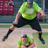 Ramon Pinero, Director of Alumni Relations at Minnesota State University jumps over Maria Pinero, Director of Operations at Northwestern Mutual as the two competed in a leap frog competition against the rival orange team at the LEEP Legends softball game on Wednesday. The game benefits LEEP, Leisure Education for Exceptional People. Photo by Jackson Forderer