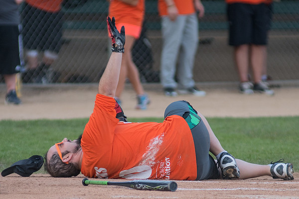 Johnny Marks, Host of the Big Hot Morning Show at Radio Mankato falls to the ground after pretending to be hit by a pitch at the LEEP Legends softball game played at Franklin Rogers Park on Wednesday. Photo by Jackson Forderer