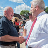 U.S. Secretary of Agriculture Sonny Perdue greets U.S. Rep. Tom Emmer, R-MN 6th District and U.S. Rep. Tim Walz, D-MN 1st District as he arrived at forum at Kevin Paap's farm on Friday. Photo by Jackson Forderer