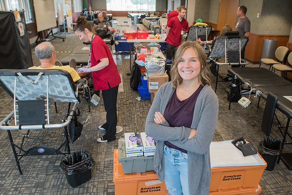 Marah Bengston (right) organized a blood drive at the Mankato Public Safety Center on Friday. In 2015 when Bengston was 15, she was struck by a boat after wake boarding and needed 16 units of blood in her recovery. The next year she began organizing blood drives with the Red Cross. Photo by Jackson Forderer