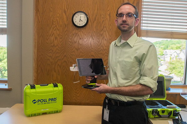 Michael Stalberger shows the new Poll Pad, which will be used at voting precincts in some Blue Earth County cities in the 2018 midterm elections. Photo by Jackson Forderer