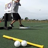 Zakk Bandemer takes a swing during The Big Wiff wiffle ball tournament Saturday.