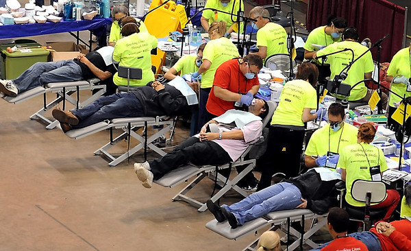 Visitors to the Mission of Mercy dental clinic have fillings worked on Saturday at the Verizon Wireless Center.
