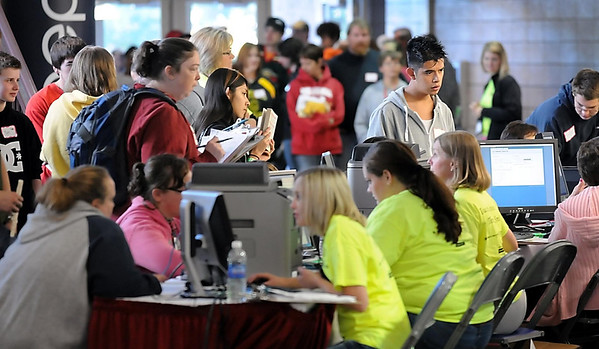 John Cross<br /> People register in the lobby of the Verizon Wireless Center Friday for the Mission of Mercy dental clinic.