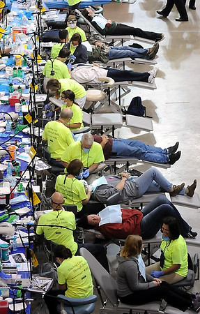 John Cross<br /> A line of patients recieve free dental care Friday at a Mission of Mercy dental clinic at the Verizon Wireless Center.
