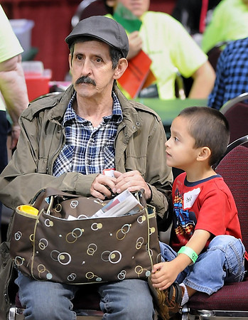 John Cross<br /> Claudio Lopez and his grandson, Andres Lopez, of Minneapolis wait to be called for an exam Friday at the Mission of Mercy dental clinic.