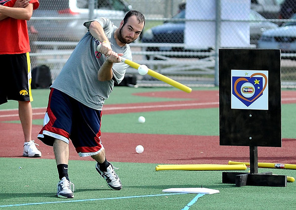 Team Nishioka's Nick Larson swings for the fence during Saturday's The Big Wiff wiffle ball tournament at the Miracle League field.