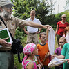 John Cross<br /> Minneopa State Park Naturalist Scott Kudelka talks to youngsters participating in a dragonfly hunt about one of the insects they captured.