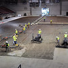 Pat Christman <br /> Workers spread and smooth concrete for a new floor for the Verizon Wireless Center Tuesday morning.