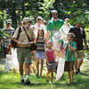 John Cross<br /> Minneopa State Park Naturalist Scott Kudelka leads a brigade of youngsters armed with butterfly nets on a dragonfly hunt.