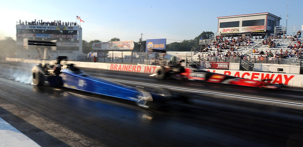 Pat Christman <br /> A pair of Top Fuel dragsters streak down the track during Friday evening's qualifying runs at the Lucas Oil NRHA Nationals at Brainerd International Raceway.
