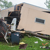 Brent Blank's garage, south of Nicollet, was damaged by one of the multiple tornadoes that touched down in the region on Wednesday afternoon. Photo by Jackson Forderer
