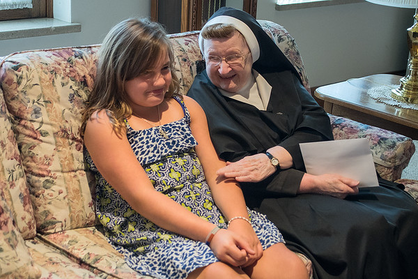Sister Adelyn Vokal (right) taps Natalie Jandera, 9, on the arm as the two talked during their weekly get together at Good Coulsel. The two have stayed friends after Natalie began writing her pen pal letters as a student at Loyola. Photo by Jackson Forderer