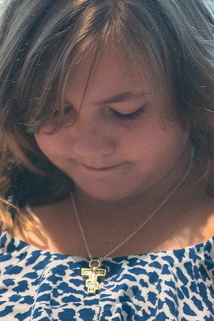 Natalie Jandera, 9, looks at her cross necklace as she talked with Sister Adelyn Vokal on Saturday. Photo by Jackson Forderer