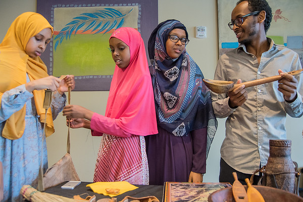 "From left, Rahima Jamac, 14, Najma Jamac, 12, Rahma Jamac, 15, and Guled Jamac look over items that were on display from the Somali Museum in Minneapolis at VINE Adult Community Center. ""We recognize a lot of this stuff from home,"" said Guled. The program at VINE, which included a presentation by Museum Director Osman Ali, was provided by Blue Earth County Library and the State Legacy Fund. Photo by Jackson Forderer"