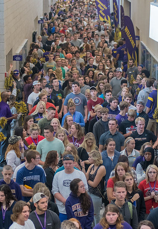 Minnesota State University freshman were welcomed by faculty, staff and returning students that lined a hallway in Myers Fieldhouse on Friday morning. The student processional, originally planned to go through the Alumni Arch, was moved indoors due to inclement weather. Photo by Jackson Forderer