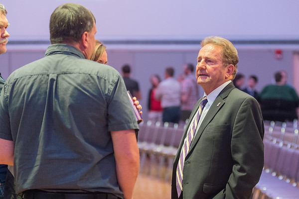 Minnesota State University President Richard Davenpot talks with a group of people at the convocation held on Monday in the CSU ballroom. Photo by Jackson Forderer