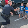 Mankato police officer Keith Mortensen shakes hands with Sawyer Brandt, 3, outside of Dunkin' Donuts on Friday. <br /> Photo by Jackson Forderer