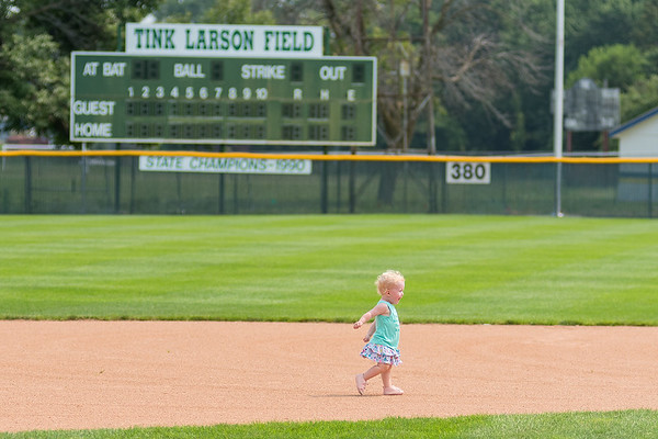 Payton Baker, 1, runs the base path between second and third base as she and others played in the field during the reopening of Tink Larson Field in Waseca. Photo by Jackson Forderer