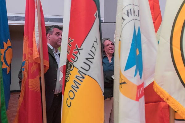 Jehad Adwan (left) and Gwen Verchota, both new assistant professors at the School of Nursing, try to identify as many countries as possible while going through foreign and Native American flags in the CSU ballroom following convocation no Monday. Photo by Jackson Forderer