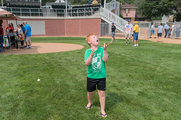 Braxton Nelson, 7, throws a baseball in the air during the reopening of Tink Larson Field in Waseca on Saturday. The grandstands were rebuilt after being destroyed by a fire. Photo by Jackson Forderer