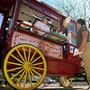 John Cross<br /> Brown County Historical Society volunteer Mary Ann Zins serves up some popcorn to Kathy Rubey of New Ulm from the restored popcorn wagon that was dedicated Tuesday during New Ulm's Capital for a Day event.