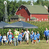 A 1940s-era farm provides a backdrop for youngsters as they travel to another learning station during Farm Camp at Farmamerica on Tuesday. Photo by John Cross