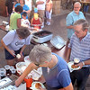 Visitors enjoy riblet sandwiches and rood beer floats during a celebration marking the 10th anniversary of the St. Peter Community Center's new building Wednesday. The old facility was destroyed by the 1998 tornado that swept through town.