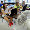 John Cross<br /> Loyola High School students in Valerie Koch's yearbook class rely on comfortable clothes and a fan to beat Thursday's steamy heat in their non-air-conditioned classroom.