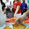 John Cross<br /> Students queue up for some of the 1,500 or so free pizza slices that Papa John's expected to serve to Minnesota State University students Wednesday during a Greater Mankato Campus & Community Fair held at MSU's Myers Fieldhouse.