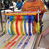 Michael Hartung of Elysian paints a T-shirt at the Zot Artz booth during his first trip to the annual SMILES Block Party.