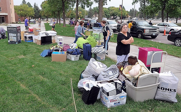 Students and parents unload vehicles outside of McElroy and Preska Residence Halls during Thursday's move-in day.