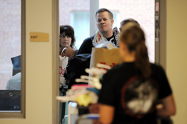 John Cross<br /> Parents and students await their turn to use the elevator Thursday while moving into the Margaret Preska Residential Hall at MSU.