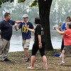 Scott Grundmeyer leads a group through some basic tai chi moves on the shores of Hiniker Pond during a light rain. He and other vendors were on hand for the first Wellness in the Park event Saturday.