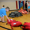 Ladden Voss and other children selects backpacks during during a backpack give-away at the YMCA on Thursday.