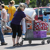 Pat Christman <br /> Nancy Mitchell helps her son David move some of his belongings into McElroy Residence Hall during Minnesota State University's move-in day Thursday.