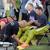 John Cross<br /> Emergency workers are fitted with protective gear at the scene of a chemical spill at the Brown Printing plant in Waseca on Thursday.