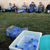 John Cross<br /> Brown Printing employees  relax in the shade of a nearby  building after being evacuated following a chemical spill  at the Waseca facility on Thursday.