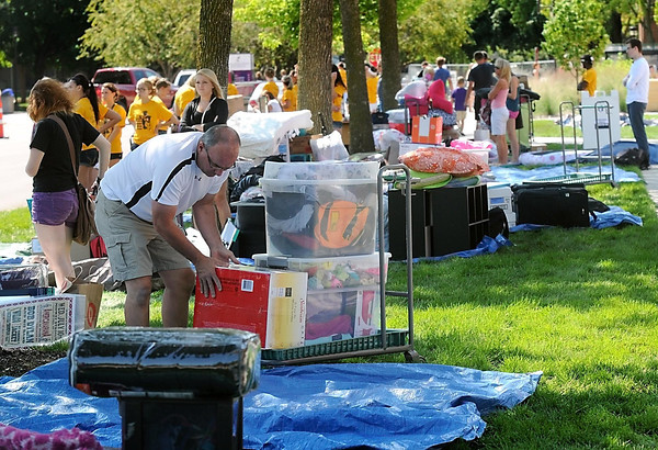 Pat Christman <br /> Students' belongings are piled up on tarps along North Ellis Avenue during Thursday's move-in day at the MSU dorms.