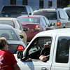 """John Cross<br /> Motorists line up for $20 worth of free gas during a """"Take Back Your Banking"""" promotion at a North Mankato gas station on Wednesday."""