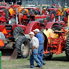 Pat Christman <br /> Two men walk through a field of tractors at the Pioneer Power Show Saturday.