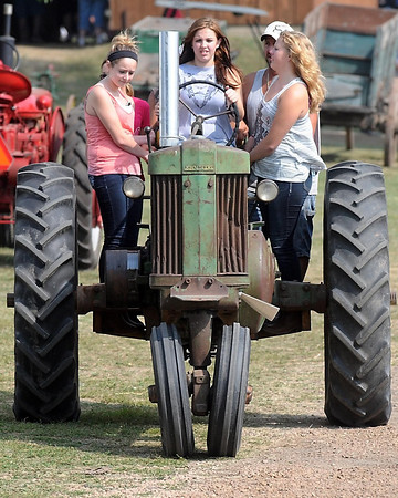 Pat Christman <br /> Melissa Baringer, 13, drives her family's tractory for the first time at the Pioneer Power Show Saturday.