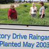 John Cross<br /> From left, Diane DeWitte of the University of Minnesota Extension Office, local master gardener Barb Maher and Catherine Fouchi of the Minnesota Department of Natural Resources view a rain garden along Victory Drive that has flourished since it was planted 10 years ago.