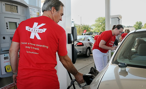 """John Cross<br /> Marv Kimm of Pioneer Bank pumps free gas at a North Mankato Kwik Trip on Wednesday as part of a national """"Take Back Your Banking"""" promotion to highlight  how local banks and credit unions fuel local economies. Employees from the bank pumped $4,000 in free gas to 200 motorists during the event."""