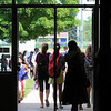 John Cross<br /> Students at Loyola High School file out of the building at noon on Wednesday . Contined heat and humidity prompted school officials to send students home early.