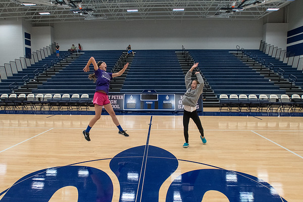 Kylee Horner (left), 13, and Keira Oeltjenbruns, 12 pretend to play volleyball in the new gymnasium at St. Peter High School during Saturday's open house of the new high school. The referendum for the new school was passed in March 2015. Photo by Jackson Forderer